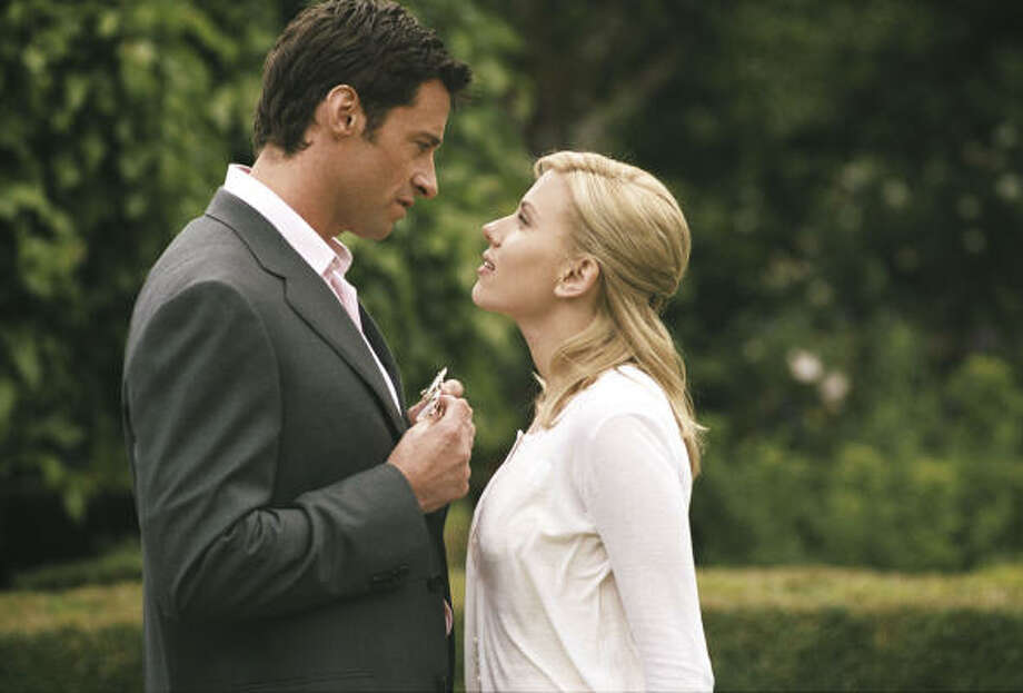 A journalist (Scarlett Johansson) tracking a serial killer finds herself drawn to an aristocrat (Hugh Jackman), in Scoop. Photo: Focus Features