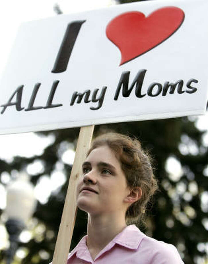 Mattie holds a sign in favor of her family's lifestyle at a polygamy rally Saturday in Salt Lake City. Photo: DOUGLAS C. PIZAC, AP