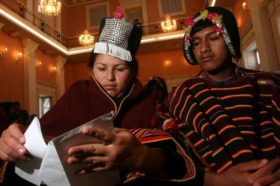 Quechua Indians Ana Maria Lopez and Wilver Veria mail a letter to President Evo Morales demanding computers for the high school in the Andean village of Tarabuco while attending Microsoft's official launch of native language software Friday in Sucre, Bolivia. Photo: DADO GALDIERI, AP
