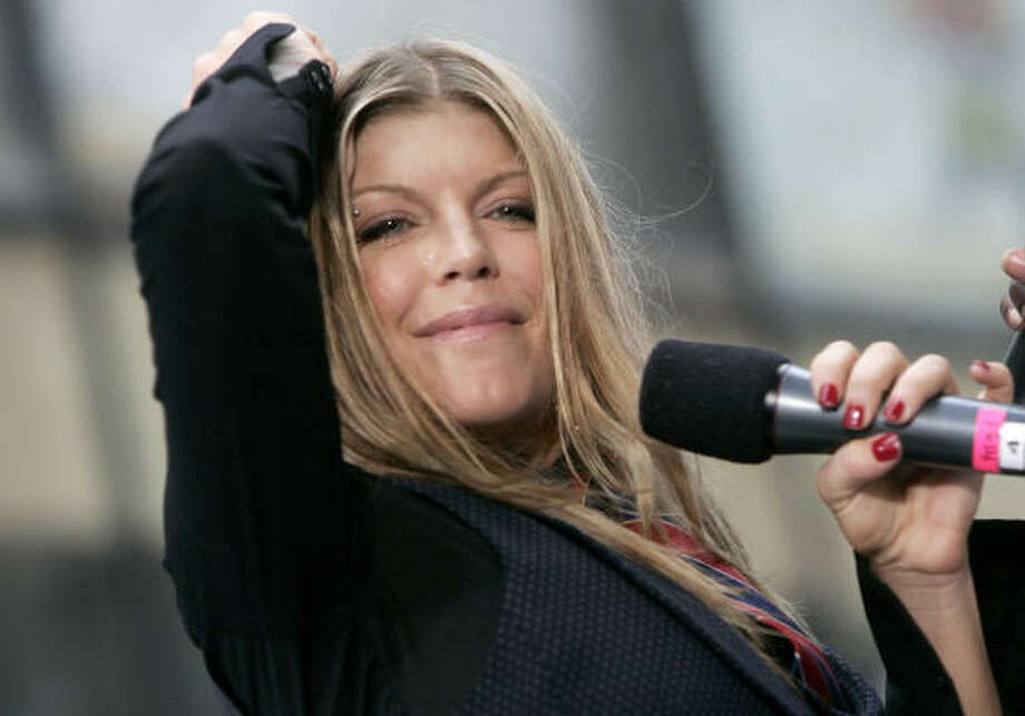 Fergie's first solo effort, The Dutchess, is a mishmash of hip-hop, funk and old-school R&B. Photo: DIANE BONDAREFF, Associated Press