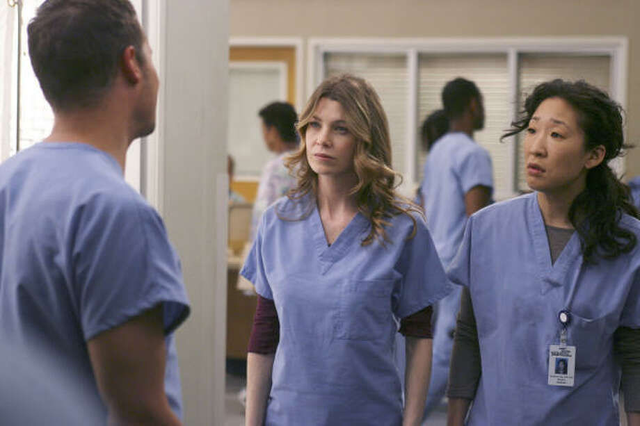 Justin Chambers, Ellen Pompeo, center, and Sandra Oh in a scene from ABC's Grey's Anatomy. Photo: ABC