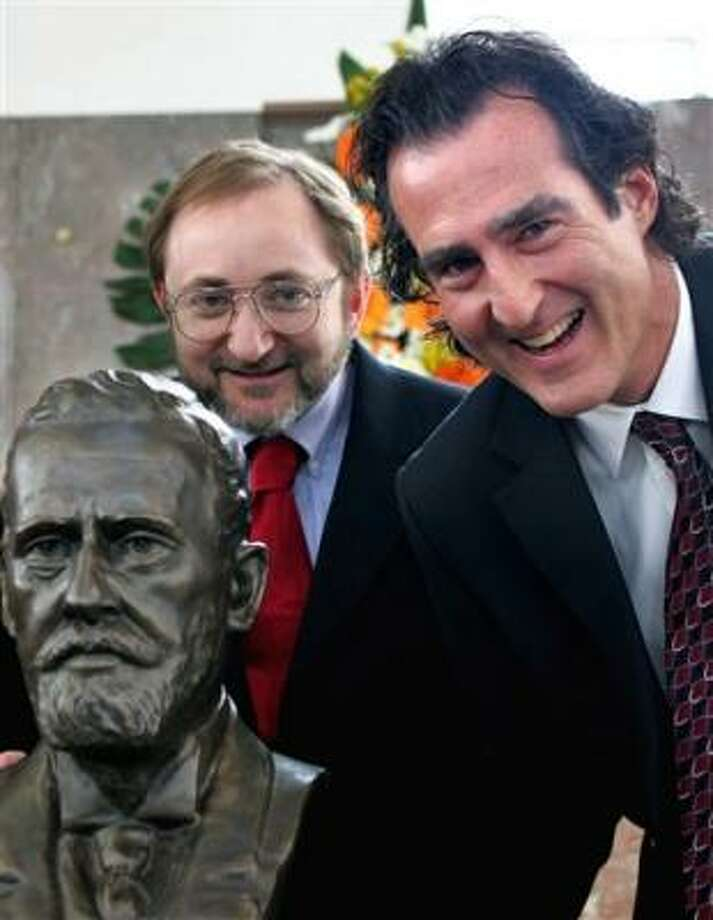 Craig C. Mello, right,  from the Howard Hughes Medical Institute at the Massachusetts Medical School in Worcester, Mass., and Andrew Z. Fire of the School of Medicine at the Stanford University in California,  pose next to a statue of German scientist Paul Ehrlich in this file photo. Photo: MICHAEL PROBST, AP