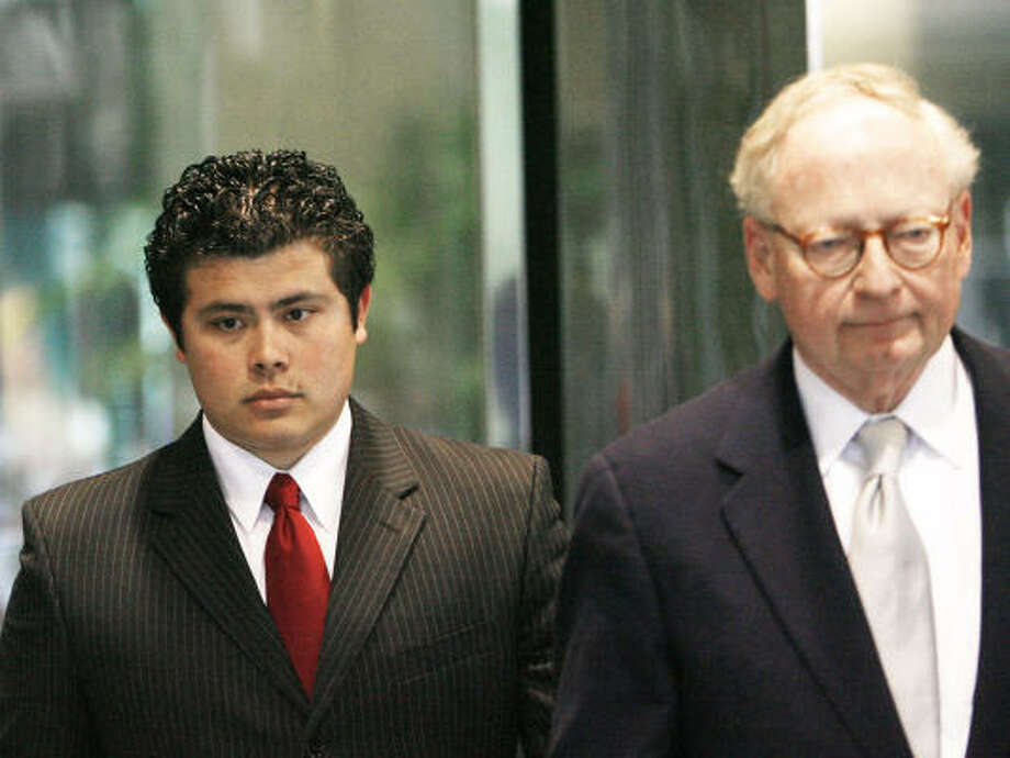 Former House page Jordan Edmund, left, accompained by his lawyer, Stephen Jones, leaves a meeting with FBI agents in Oklahoma City. Photo: DAVID MCDANIEL, AP