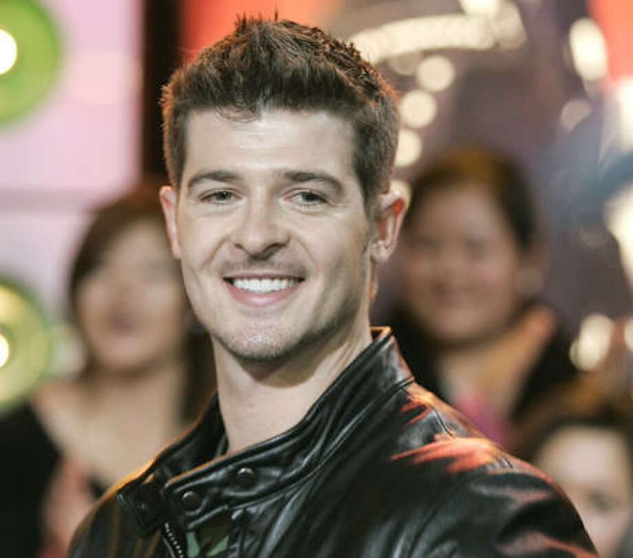 The Evolution of RobinThicke is the singer's second go-around at a place in contempo R&B. Photo: JEFF CHRISTENSEN, Associated Press