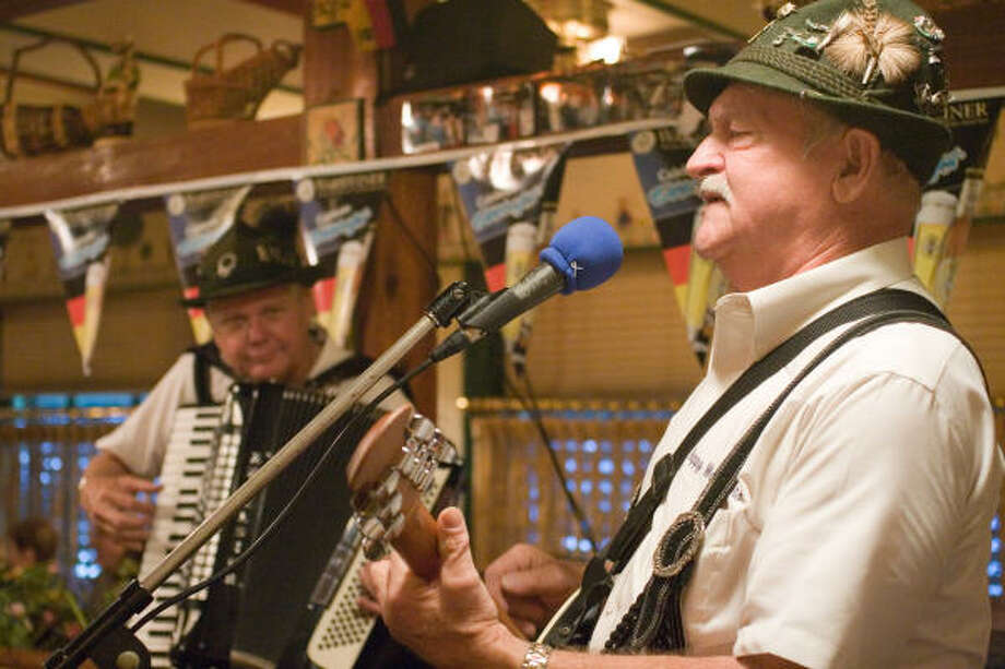 Band leader Peter Menzelon on guitar, right,  and Jerry Steinocher on accordion are two members of the Happy Wanderers band that is much in demand this time of year. Photo: R. Clayton McKee, For The Chronicle