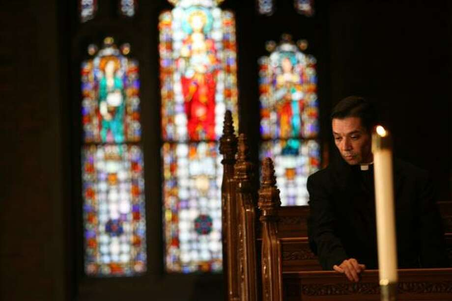 Monsignor Daniel Flores, 45, of the Diocese of Corpus Christi, pauses at Sacred Heart Major Seminary Chapel in Detroit on Saturday. Photo: KIMBERLY P. MITCHELL, Detroit Free Press