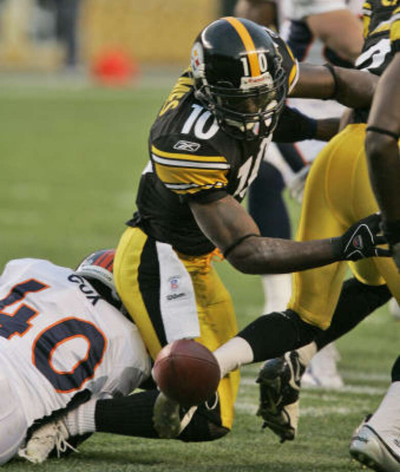 Turnovers like this fumbled punt by Santonio Holmes are killing the Steelers. They have 24 this season, one more than they had in all of last season. Photo: GENE J. PUSKAR, AP