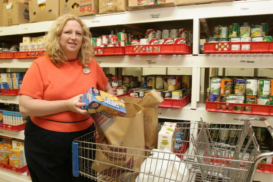 Diane Clark, 44, food pantry coordinator at East Fort Bend Human Needs Ministry, is organizing food to feed many area families this holiday season. Photo: Suzanne Rehak, For The Chronicle