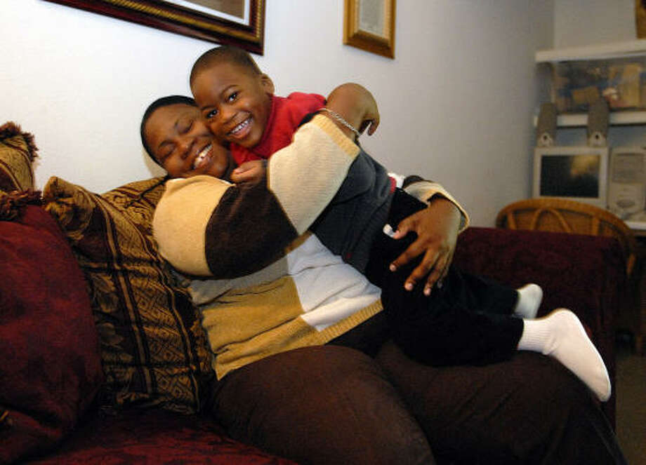 Andrea Broadway, 30, enjoys a hug from her son, Nicholas Blu', 3, at their apartment. Broadway suffers from blood and heart problems, and most of her benefits go to bills and medical expenses. Photo: KIM CHRISTENSEN, For The Chronicle