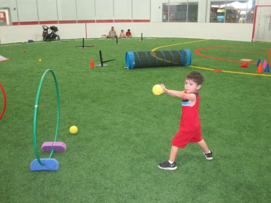 Adrian Alanis throws a baseball in an Alamo TotSports class at The Ice and Golf Center at Northwoods. Photo: Photo By Ana Clarissa Rodriguez,  _