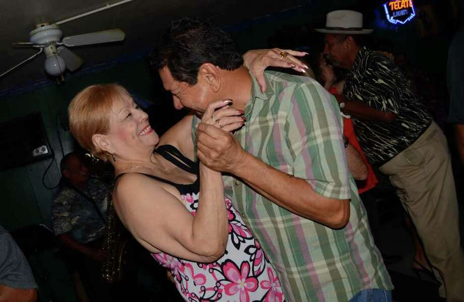 Lupie Sal and Jimmy Ramirez get sweet on the dance floor at Southtown Tavern. ROBIN JOHNSON / SPECIAL TO THE EXPRESS-NEWS