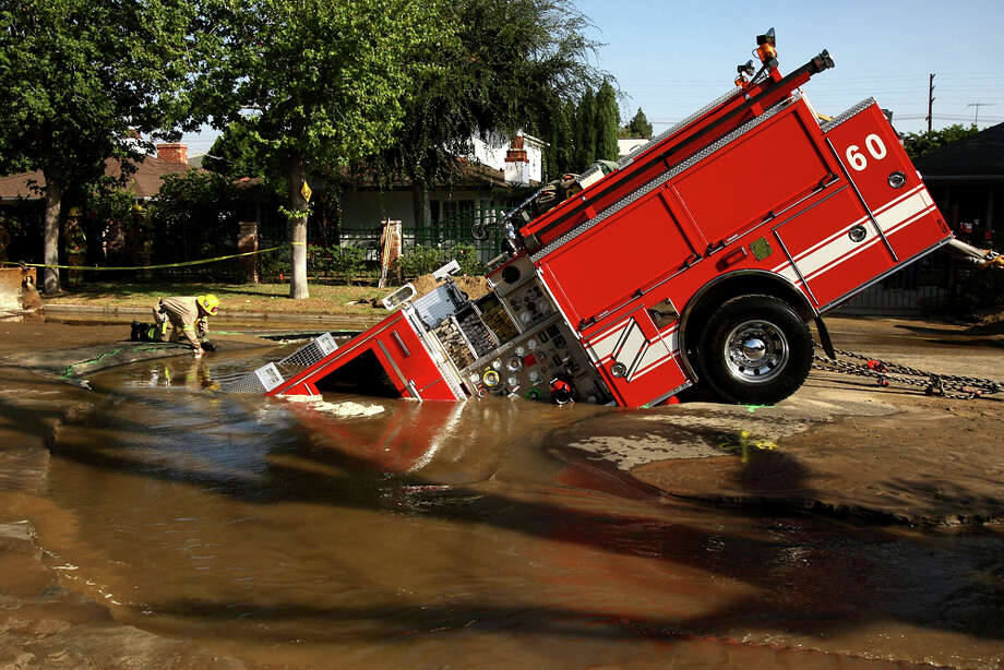 A 22-ton Los Angeles Fire Department fire truck protrudes from a 