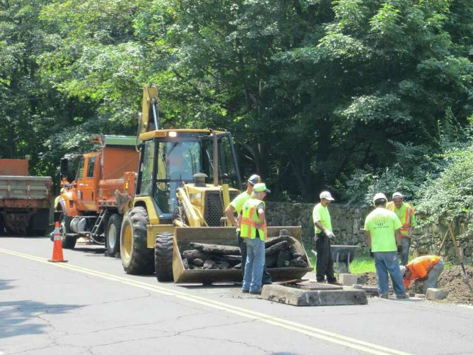 Even on hot summer days, the work outside has to get done. State crews were hard at work on Mansfield Avenue in Darien getting the roadway ready to be resurfaced. - Photo by John H. Palmer Photo: File Photo