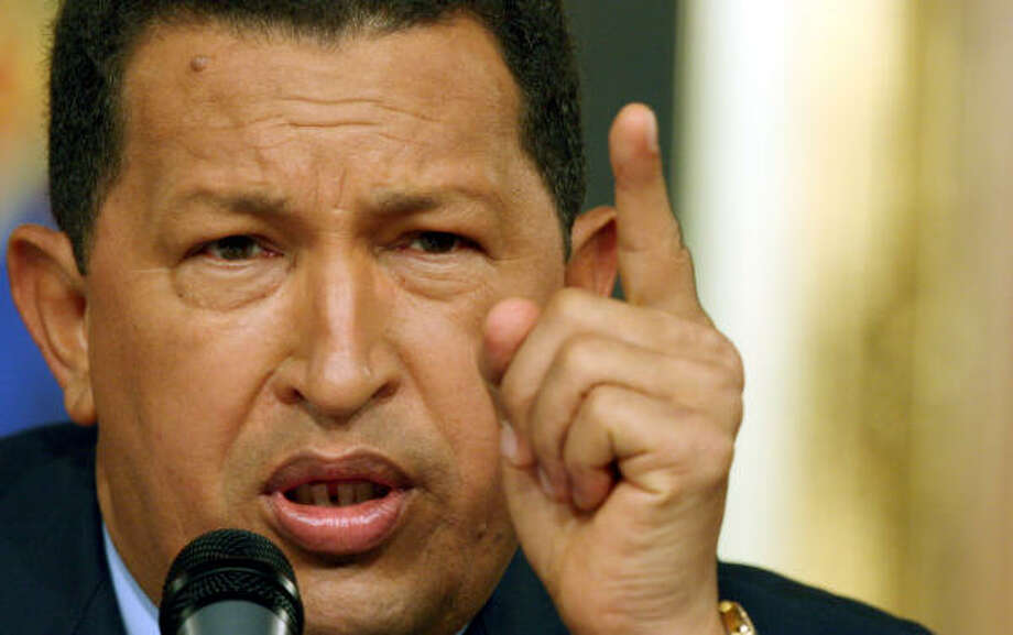 Unlike the Venezuela's aloof leaders of the past, President Hugo Chavez combines humor and personal anecdotes with stinging denunciations of the rich to connect to the country's poor. Photo: HOWARD YANES, AP