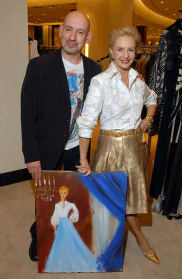 Artist Luis Arsenio González presents a painting to designer Carolina Herrera at Saks Fifth Avenue, where she was special guest at a benefit for the Moores School of Music. Photo: Dave Rossman, For The Chronicle