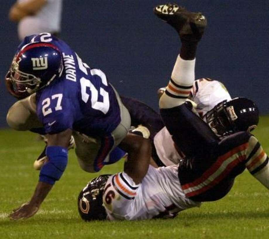 Ron Dayne was a first round pick of the New York Giants after winning the Heisman Trophy at Wisconsin, but never lived up to the high expections. Photo: BILL KOSTROUN, AP