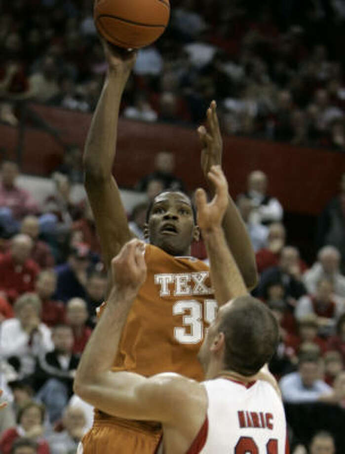 Texas' Kevin Durant puts up a shot over Nebraska's Aleks Maric in the first half. Photo: Nati Harnik, AP