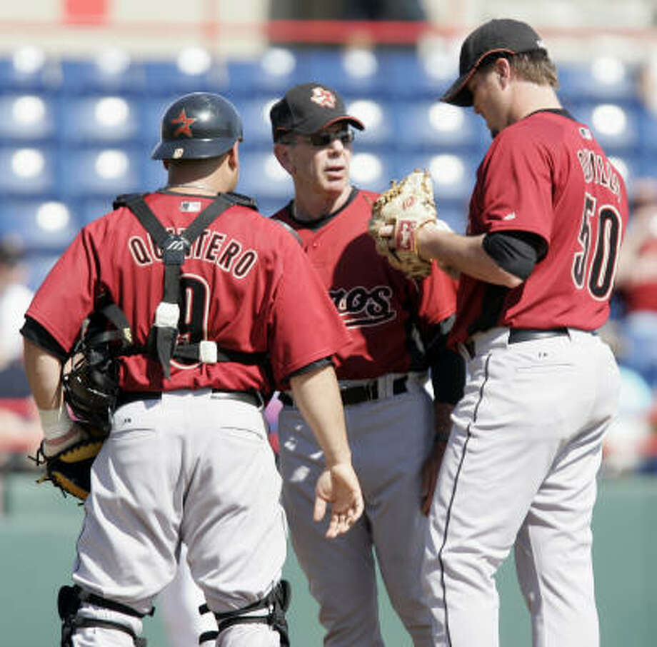 Pitching coach Dave Wallace (center) has been overseeing development of candidates for the rotation. Photo: Evan Vucci, AP