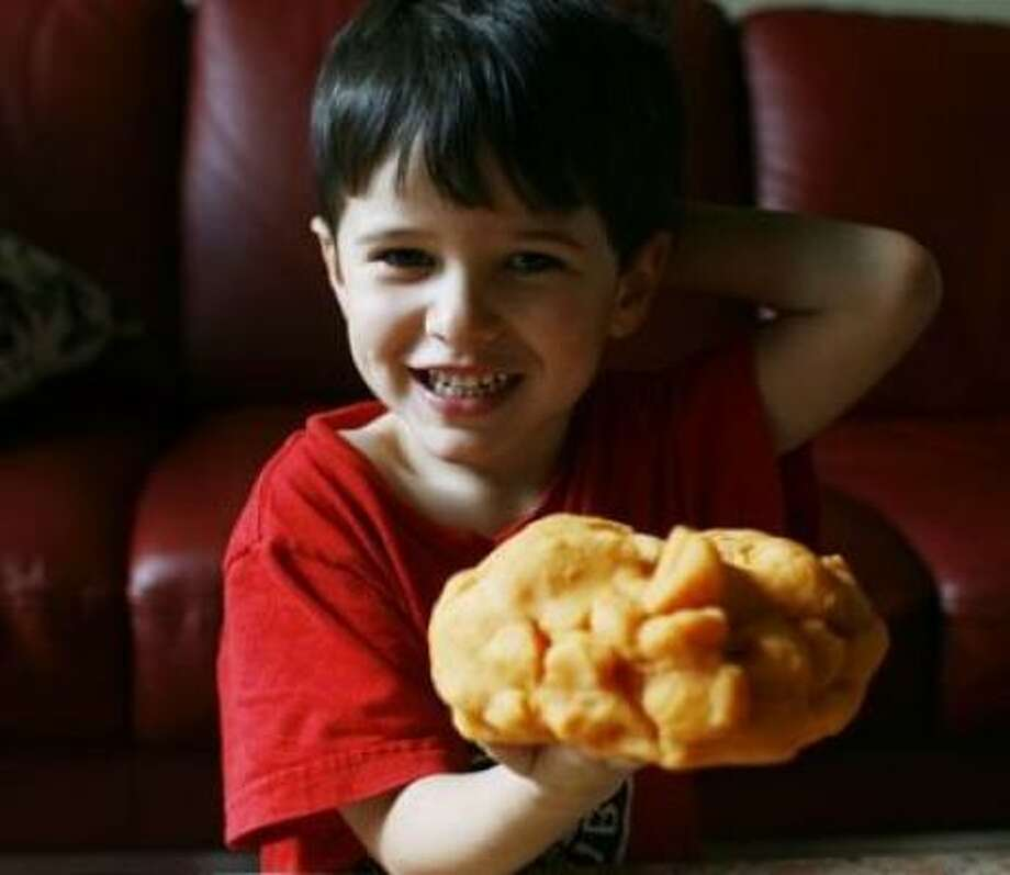 Carlos de la Torre, 4, shows off the homemade orange play dough made by his mom, writer Maggie Galehouse. Photo: NICK DE LA TORRE, CHRONICLE