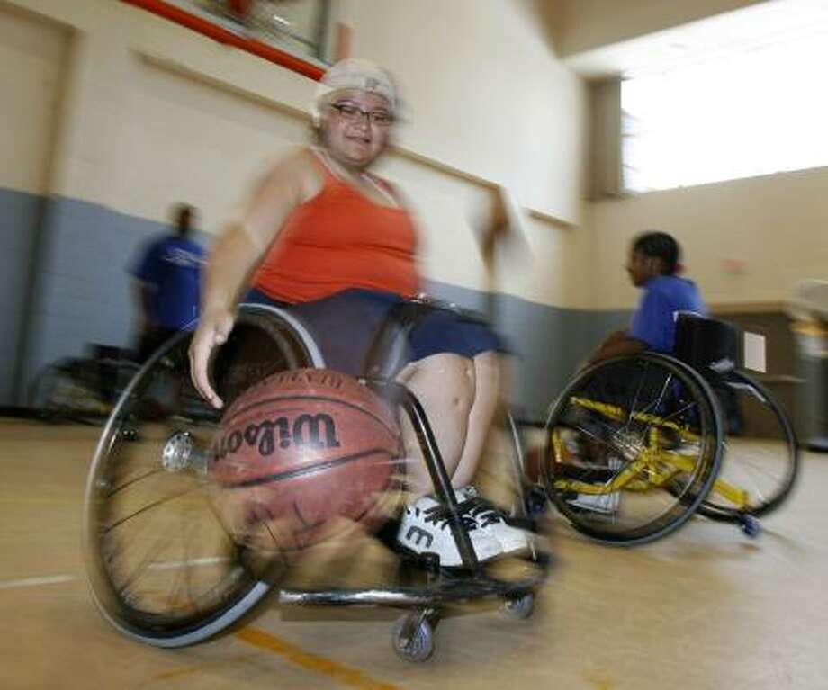 Elizabeth Acosta, 18, will go to the University of Arizona this fall on a wheelchair basketball scholarship. Photo: KAREN WARREN, CHRONICLE