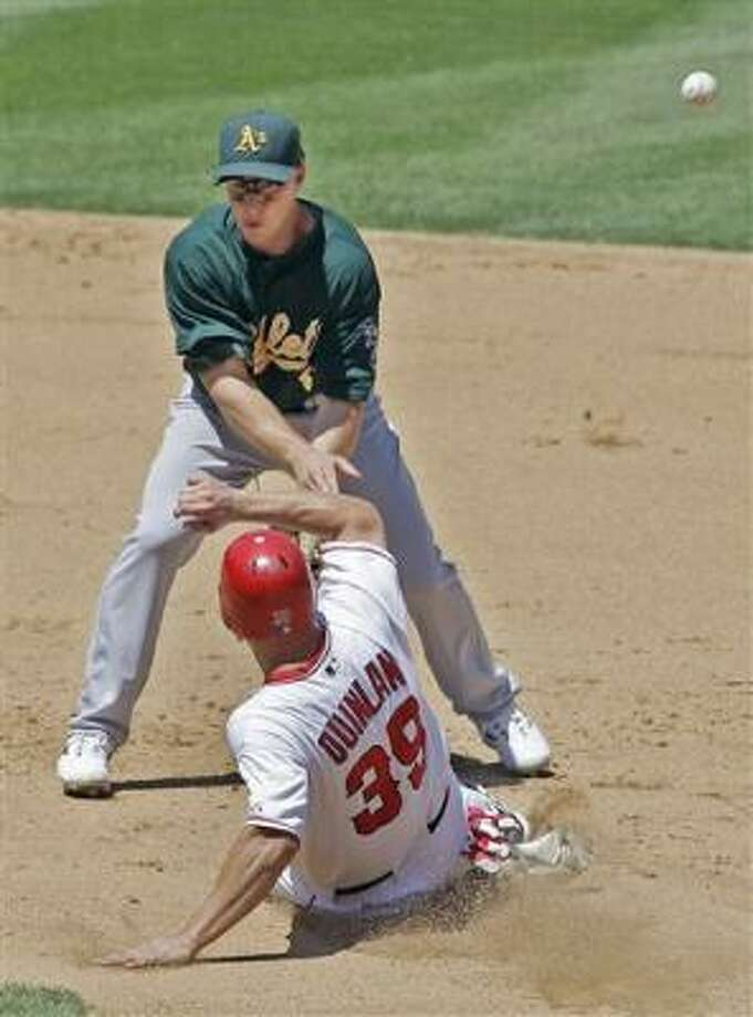 L.A.'s Robb Quinlan is safe at second on a steal. He and the Angels are in first in the AL West. Photo: Kevork Djansezian, AP