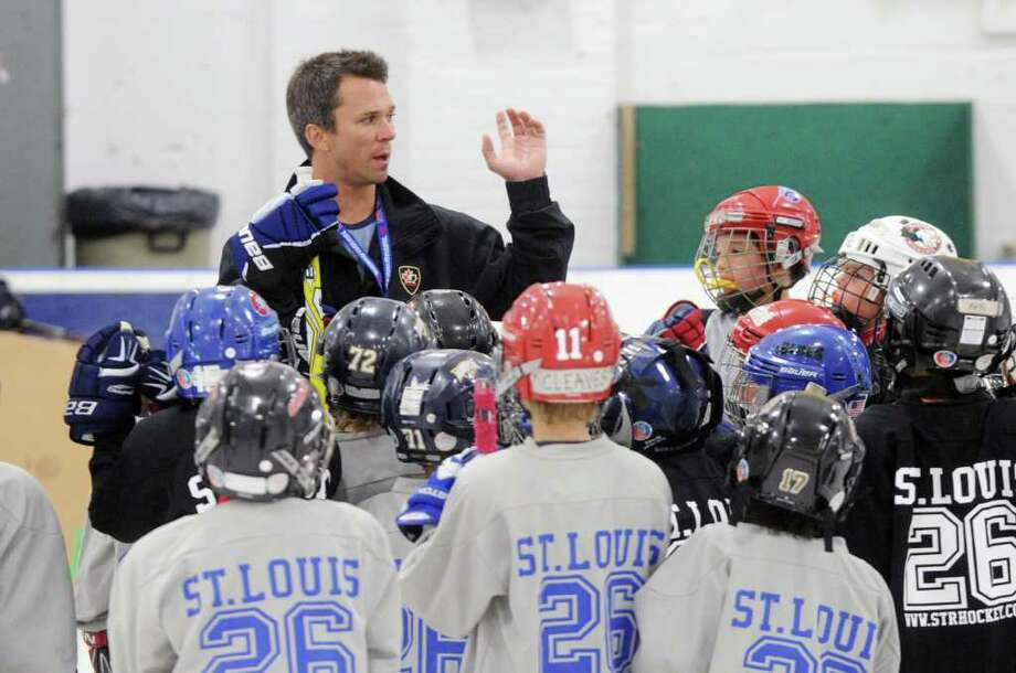 Martin St. Louis of the Tampa Bay Lightning conducts hockey camp at Stamford Twin Rinks in Stamford, Conn., July 21, 2011.  Matt Moulson of the New York Islanders also taught at the camp. Photo: Keelin Daly / Stamford Advocate