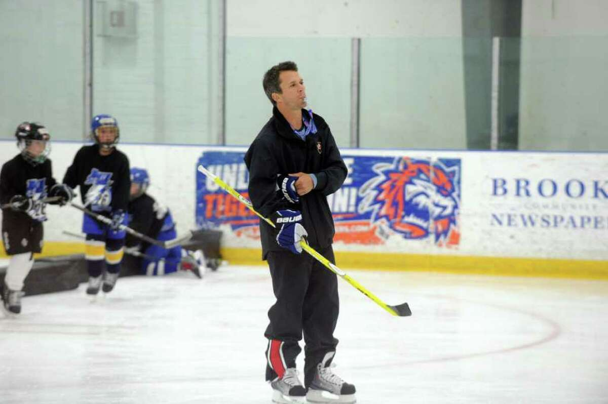 Martin St. Louis of the Tampa Bay Lightning conducts hockey camp at Stamford Twin Rinks in Stamford, Conn., July 21, 2011. Matt Moulson of the New York Islanders also taught at the camp.