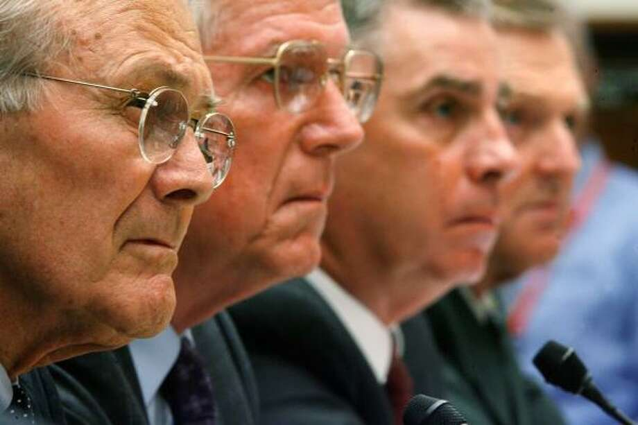 From left,  ormer Secretary of Defense Donald Rumsfeld, former Chairman of the Joint Chiefs of Staff Richard Myers, former commander of the U.S. Central Command retired Gen. John Abizaid and past commander of the U.S. Special Operations Command retired Gen. Bryan Brown testify before the House Oversight and Government Reform Committee today. Photo: Chip Somodevilla, Getty Images