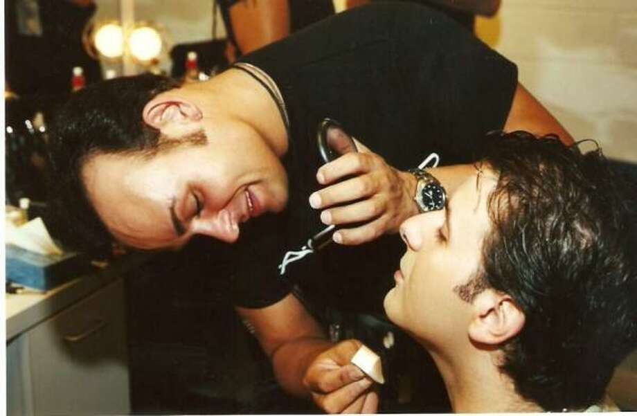 East End resident Jody Miller is a makeup artist who has worked on many famous faces, including those of actors Brad Pitt and Sandra Bullock. Here he applies makeup to KUHT-TV Channel 8 personality Ernie Manouse. Photo: James Dinkins, Contributed Photo