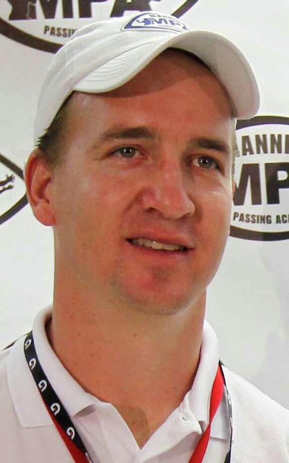 """FILE - This July 8, 2011 file photo shows Peyton Manning during a news conference at the Manning Passing Academy at Nicholls State University,  in Thibodaux, La.  Indianapolis Colts owner Jim Irsay believes Peyton Manning's neck surgery will not slow down the league's only four-time MVP this season. At the owner's meetings in Atlanta, Irsay said Thursday, July 21, 2011 that Manning is doing well and he expects Manning to """"be ready."""" (AP Photo/Gerald Herbert, FIle) Photo: Gerald Herbert, STF / AP2011"""
