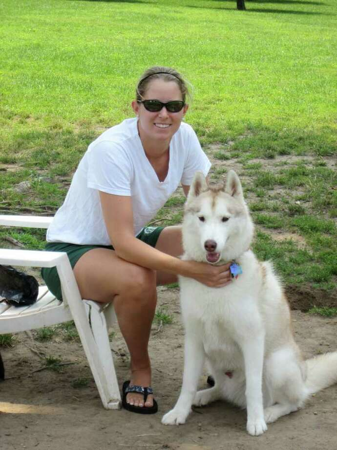 Man's best friend enjoys a day out at the park, too. Julie Cofone of Norwalk and her husky, Kodiak, enjoy a summer day at Waveny Park. - Photo by john H. Palmer Photo: File Photo