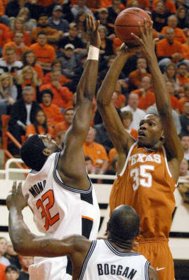 Texas' Kevin Durant (35) shoots while being challenged by Oklahoma State's David Monds, left, and Mario Boggan, center, during the second half of their Jan. 16 Big 12 showdown at Stillwater, Okla. Durant scored 37 points, but his Longhorns lost to the Cowboys 105-103 in three overtimes. Photo: Brody Schmidt, AP