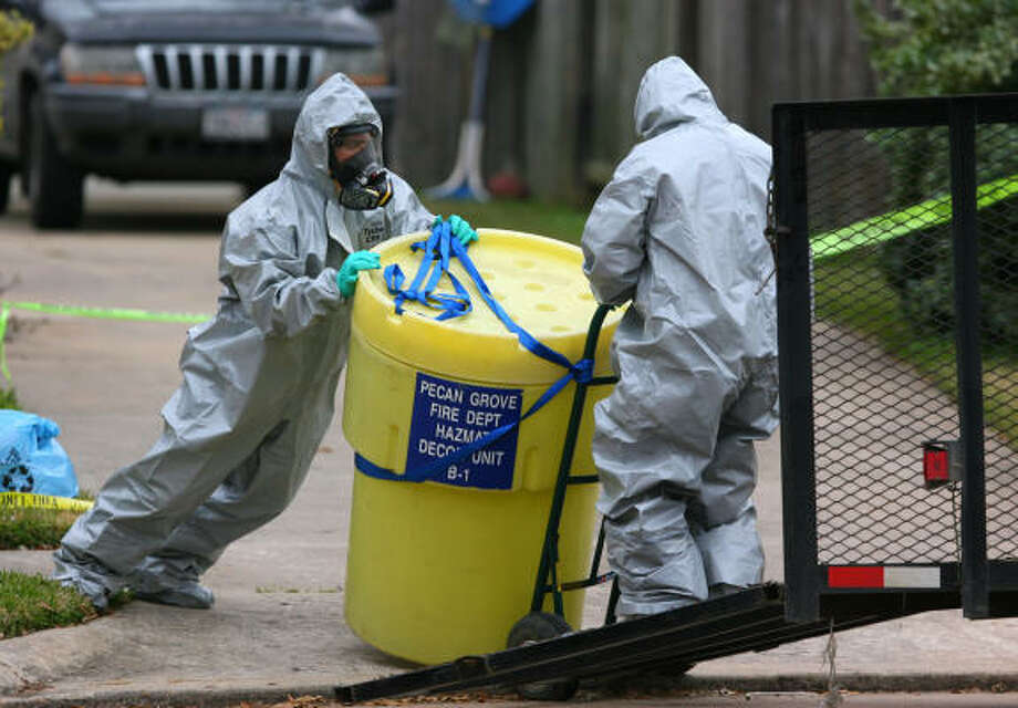 Garner Environmental Services workers decontaminate the Fort Bend County home where a man attempted suicide using potassium cyanide. Photo: Bob Levey, For The Chronicle