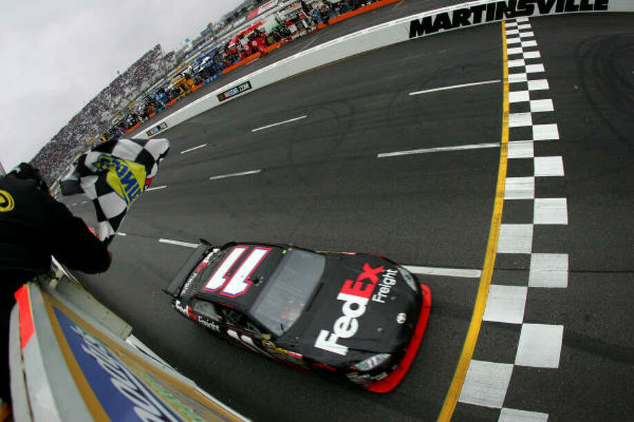 Denny Hamlin beat a pair of Jeffs (Gordon and Burton) to the finish line at Martinsville to take the checkered flag. Photo: Chris Trotman, Getty Images