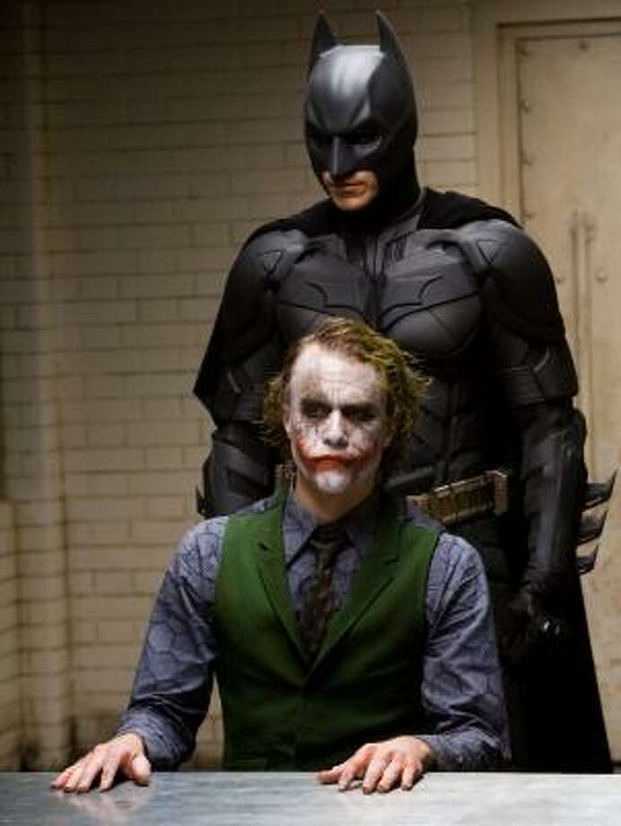 The late Heath Ledger stars as the Joker and Christian Bale stars as Batman in The Dark Knight. The Batman movie beat out The Mummy: Tomb of the Dragon Emperor at the weekend box office. Photo: Handout, WARNER BROS. PICTURES