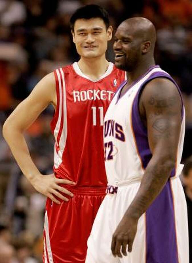 "Rockets center Yao Ming (11) is looking forward to a ""straight-up"" matchup against Phoenix Suns center Shaquille O'Neal (right) in tonight's game at Toyota Center. Photo: Matt York, AP"