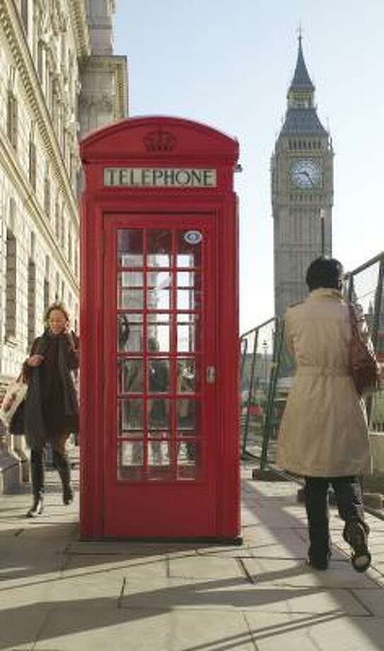 The iconic telephone box in Britain may be outmoded and unprofitable, but hamlets are resolving to keep them on the streets. Photo: SANG TAN, ASSOCIATED PRESS