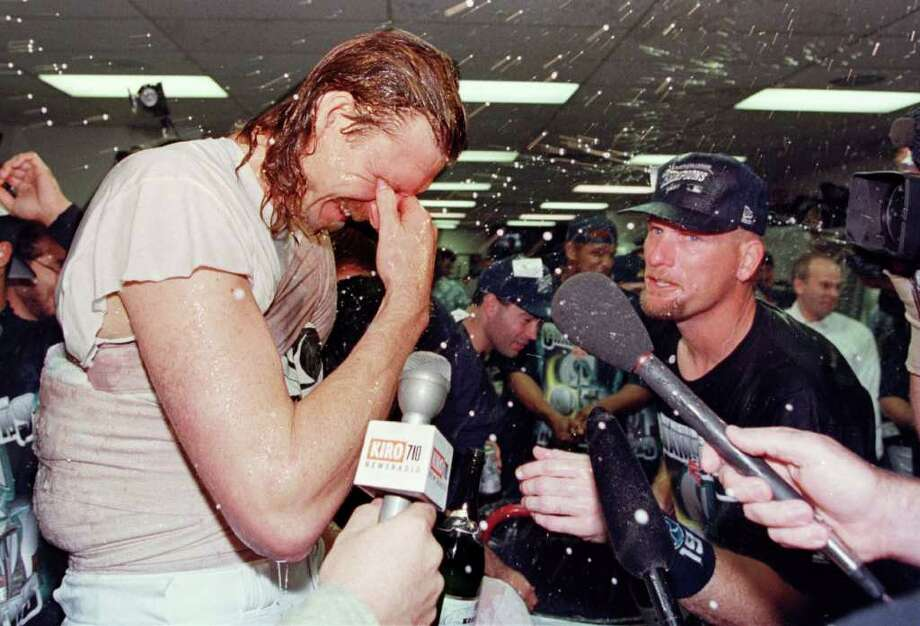 If Seattle fans have learned anything from rooting for mediocrity for so long, it's how to appreciate small victories. And 1997 was full of them. No Seattle team won a title, but looking back, 1997 was an all-around great year for local sports. So as we wallow in the doldrums of another lost Mariners season, it can't hurt to look back to happier days. One of those days was Sept. 23, 1997, when the Mariners clinched the American League West with a 4-3 win over the California Angels. Randy Johnson, left, struck out 11 in eight innings to get the win. Jay Buhner, right, added a three-run homer. Photo: DAN LEVINE, AFP/Getty Images / AFP
