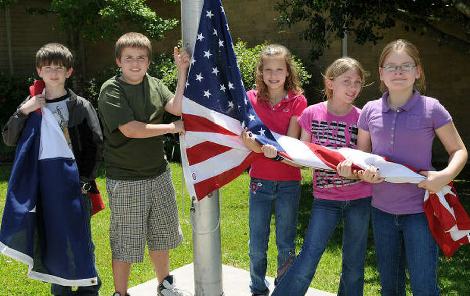 PATRIOTIC DUTY: Justin Meredith, Nicholas Whitaker, Destiny Bowers, Maxine Ortner and Jordan Hammock, each 11 years of age and fifth-graders at Porter Elementary, are members of the school?s ambassadors program. The ambassadors are in charge of raising and lowering the school?s U.S. flag each school day. Photo: Jerry Baker, For The Chronicle