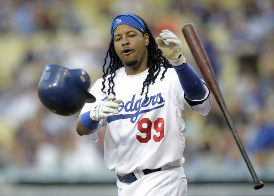Dodgers' Manny Ramirez was frustrated by Roy Oswalt on Friday, a day after Wandy Rodriguez held Ramirez to one hit. Photo: Jae C. Hong, AP