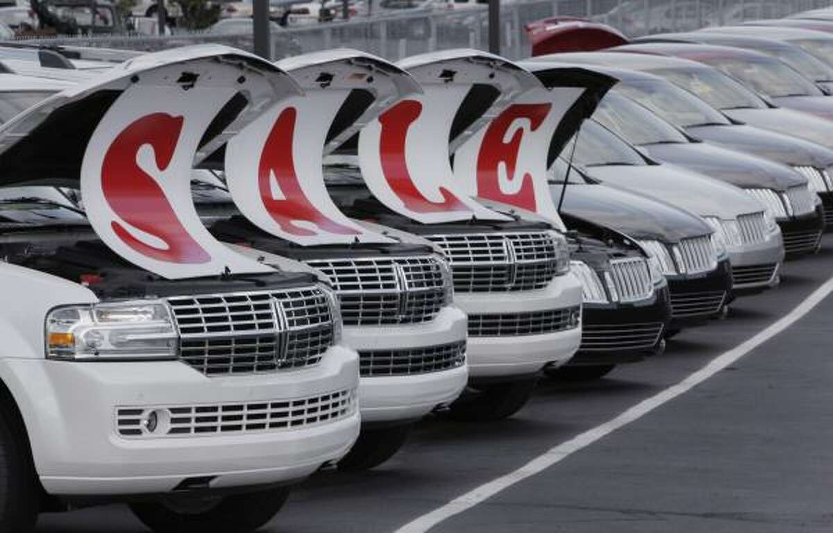Lincoln Mercury vehicles are shown on a lot in Sterling Heights, Mich. Ford said its U.S. sales in August rose 17.2 percent over last year, fueled by the Cash for Clunkers program.