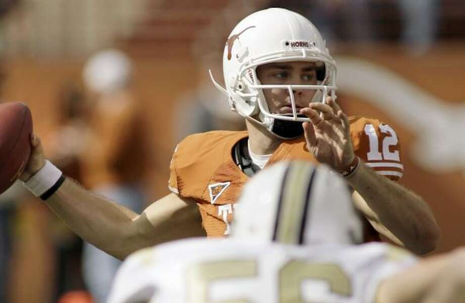 Texas quarterback Colt McCoy fell just short of Major Applewhite's school record for passing yards in a game. Photo: Harry Cabluck, AP