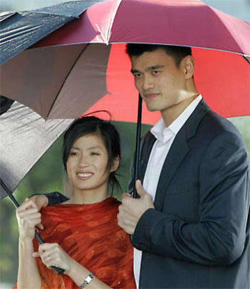 Yao Ming and his wife, Ye Li, are expecting a baby in July. Photo: Pat Sullivan, Associated Press