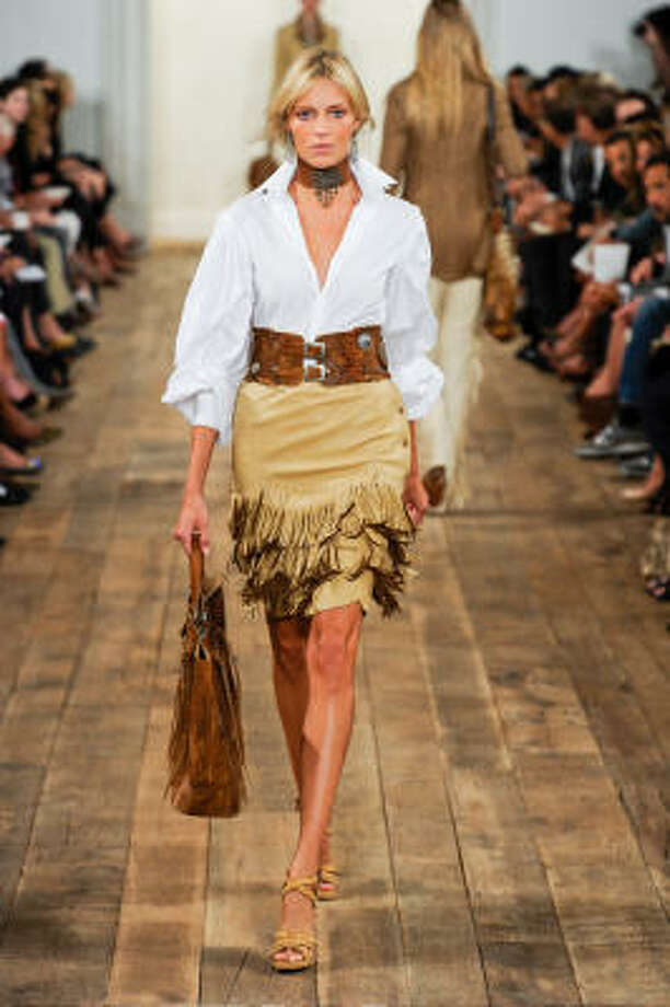 Ralph Lawuren's rodeo chic look for Spring 2011 is a fringed leather skirt with a white blouse cinched at the waist. Photo: Stylesight