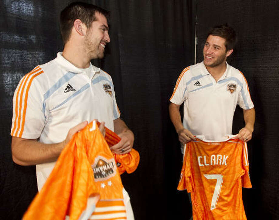 Jason Garey left, and midfielder Colin Clark will be a big part of the Dynamo's plans this season. Photo: James Nielsen, Chronicle