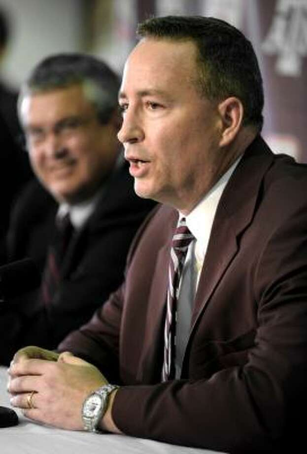 Newly appointed A&M head basketball coach Bill Kennedy answers questions during a news conference as athletic director Bill Byrne, left, looks on Monday in College Station. Photo: Dave McDermand, Associated Press