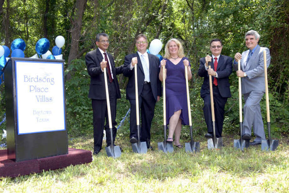 Drs. Siraj Jiwani, Robert Johnston, Caroline Johnston, Rafael Pardo and Ricardo Pardo all break ground on the Birdsong Place Villas in Baytown. Photo: Kim Christensen, For The Chronicle