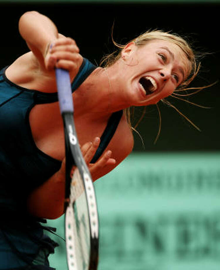 Maria Sharapova puts some strain on her right shoulder during Wednesday's first-round victory over Emilie Loit. Photo: Clive Brunskill, Getty Images