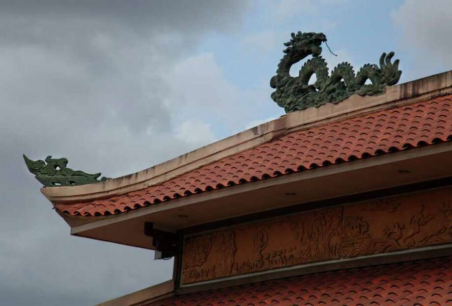 A decorative metal dragons sit on the corners of the Buddha Hall at Vietnamese Buddhist Center on Sunday, July 10, 2011, in Houston.  On a Sunday along Synott Road is where the Houston area shows its religious diversity, an edge-of-Sugar Land street lined by immigrants' places of worship such as St. Basil the Great Greek Orthodox church, The Vietnamese Buddhist Center, The Chinmaya Praba Mission. ( Mayra Beltran / Chronicle ) Photo: Mayra Beltran, Staff / © 2011 Houston Chronicle
