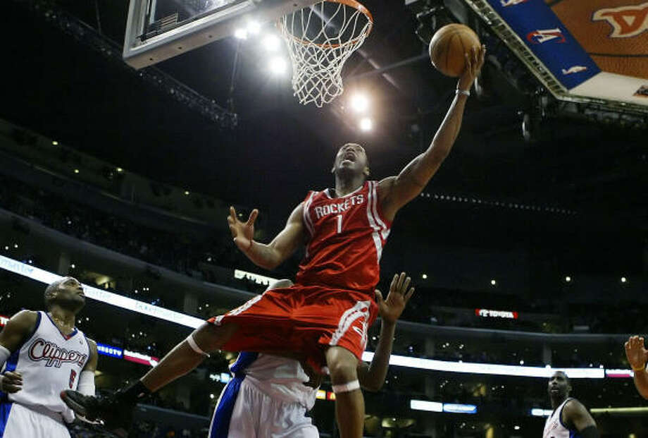 Tracy McGrady makes a move to the basket in the first half against the Clippers. He finished with 27 points in the Rockets' win. Photo: Kevork Djansezian, AP